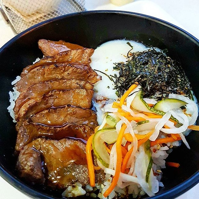 The Australian Wagyu Beef Don with Oozing Onsen Egg , picked veggies topped with Donburi sauce & Shredded Seaweed.
