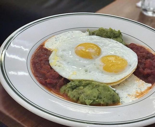 【Huevos Rancheros】Sunny side-up eggs with red beans, guacamole, jalapeño sour cream, salsa picante, pepper jack cheese, house made corn tortilla #clintonstreetbakingcompany #cafe #cafesg #sgcafe #foodstagram #westernfood #alldaybreakfast #huevosrancheros #foodporn #instafood #instafoodie #sgfood #sgfoodies #burpple #burpplesg