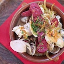 hearty hot starter of spanish chorizo squid and white clams in seafood broth ($23).