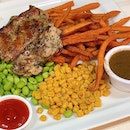 Signature Chicken Chop ($9.50) Served with sweet potato fries, edamame and sweet corn.