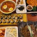 Kimchi pajeon ($10.80), Beef gimbap ($9.80), Tteokbokki (), Jajangmyeon ($11.90)