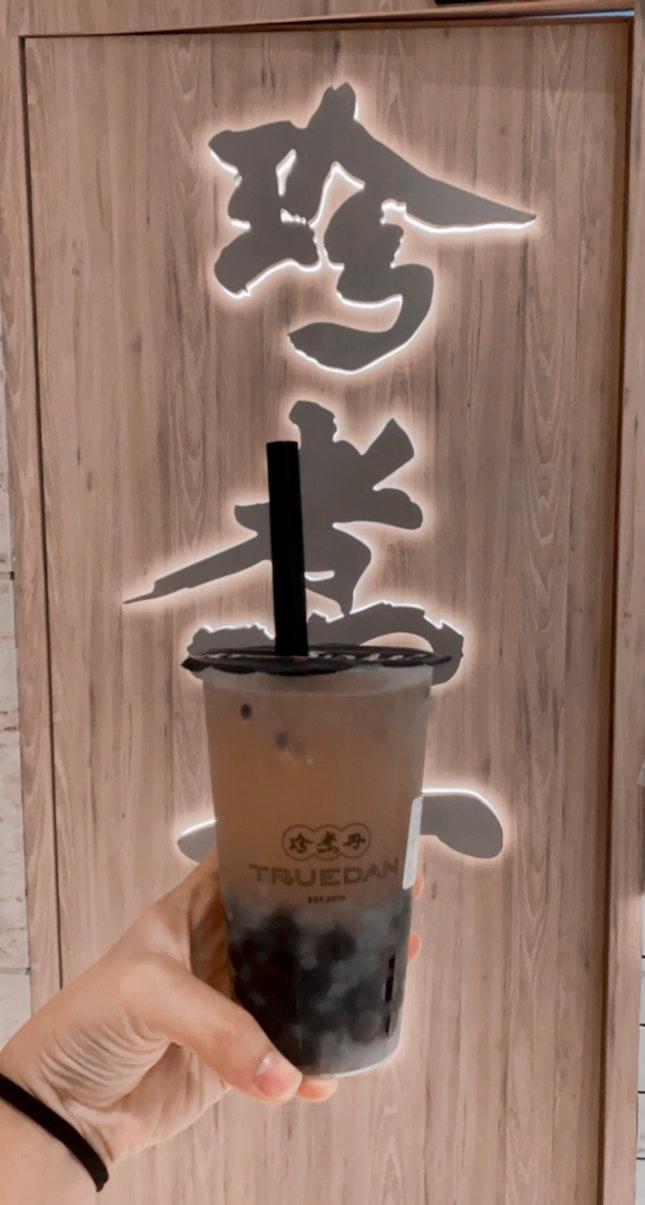 Passionfruit green tea w Nata de Coco & Brown sugar boba ($5.90)