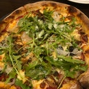 Pizza with amazing crust, great squid ink pasta too