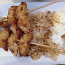 Fried Gyoza Skewers With Bonito Flakes