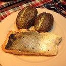 Crispy skinned salmon with cheesy baked potatoes.