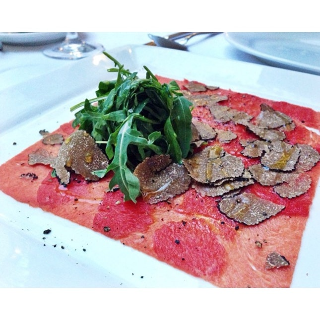 Wagyu beef carpaccio with rucola salad & shaved Scorzone summer black truffle.