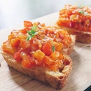 Bruschetta - homemade toast w tomato salad