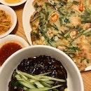 jjajangmyeon ($13), seafood spring onion pancake ($25)