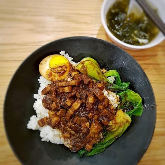 Braised pork rice .