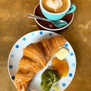 Croissant and Flat White.