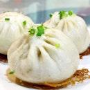生煎包 Shengjian Bao, is a type of small, pan-fried baozi which is a specialty of Shanghai.