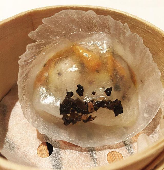 Steamed Shrimp Dumpling with Black Truffle and Cordyceps Flower.