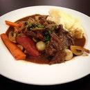 Beef bourguignon ($19): beef shin braised in red wine, served with carrots, smoked bacon, mushrooms and mashed potato.