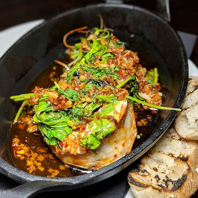 Garlic Prawns (prawns, olive oil, garlic, sambal oelek, seared coriander, served with slices of pide) from Claypots Full Circle (@claypotsfullcircle), a seafood restaurant and bar along Amoy Street serving sharing plates influenced by Mediterranean and Asian flavours.