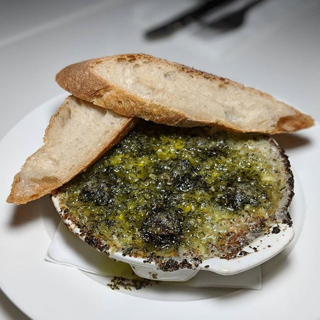 The Early Fatback: Grand Jean Escargots with Garlic Butter and Baguette from Culina at COMO Dempsey (@culinacomodempsey).