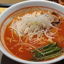 Simple bowl of tomato ramen with Happy people .