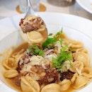 Orecchiette pasta in braised veal cheek ragout cooked in Manduria Primitivo red wine