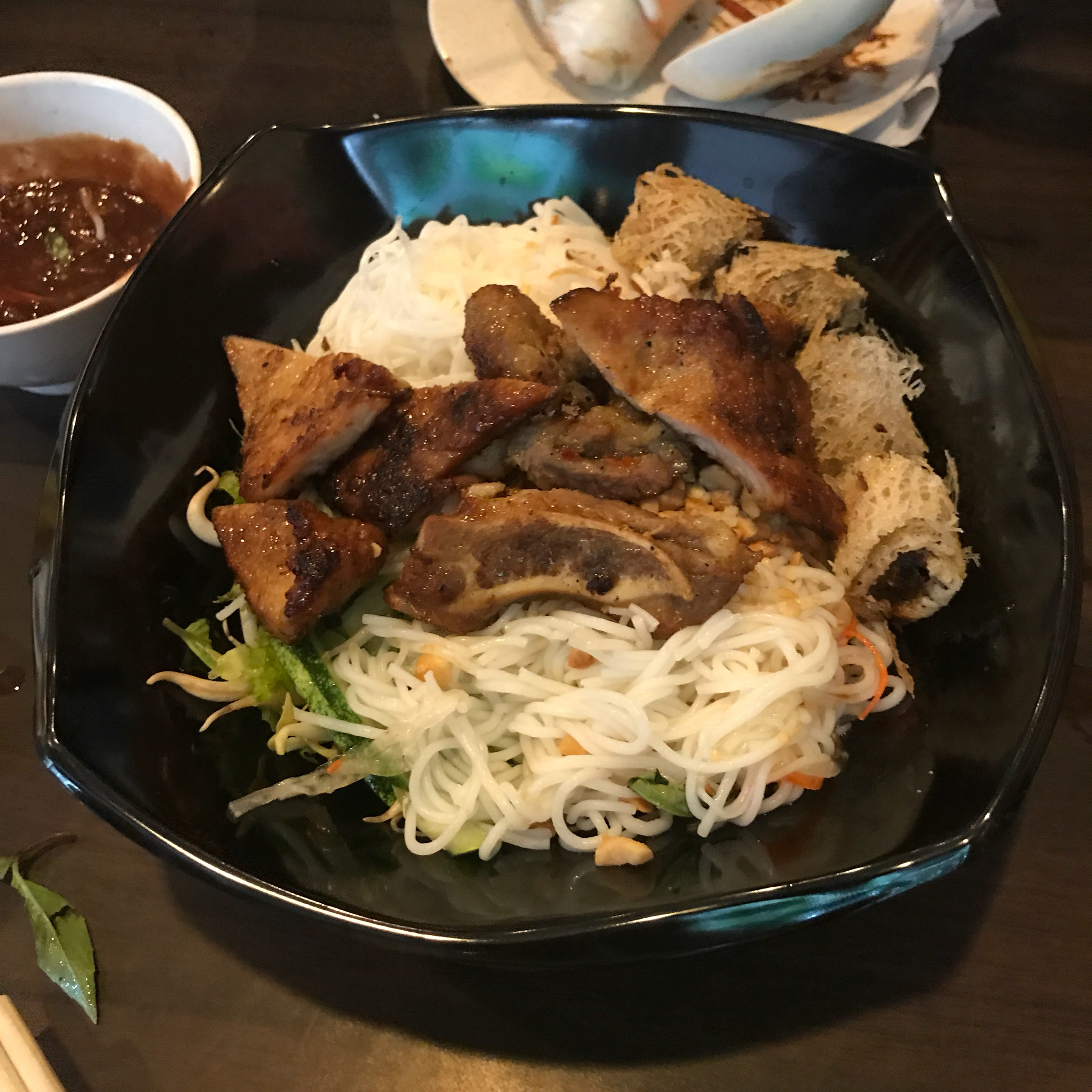 Rice Noodles With Grilled Pork And Fried Spring Rolls ($8.50)