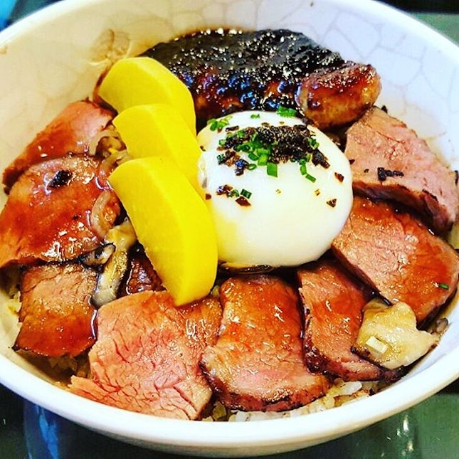 Foie Gras Truffle Yakiniku  Pan Seared Foie Gras, US Black Angus Short Rib, Onsen Egg, Truffle Soy, Black Garlic Brown Butter over Tanuki's signature mixed rice  The foie gras teases with its melt in your mouth awesomeness.