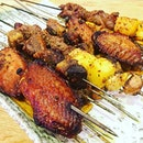 BBQ meat  A variety of grilled items such as lamb meat, lamb tendon with pineapple, mushrooms and beancurd skin etc served in skewers.