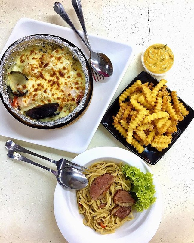 Seafood Baked Rice, salted egg yolk fries and smoked duck Aglio olio.