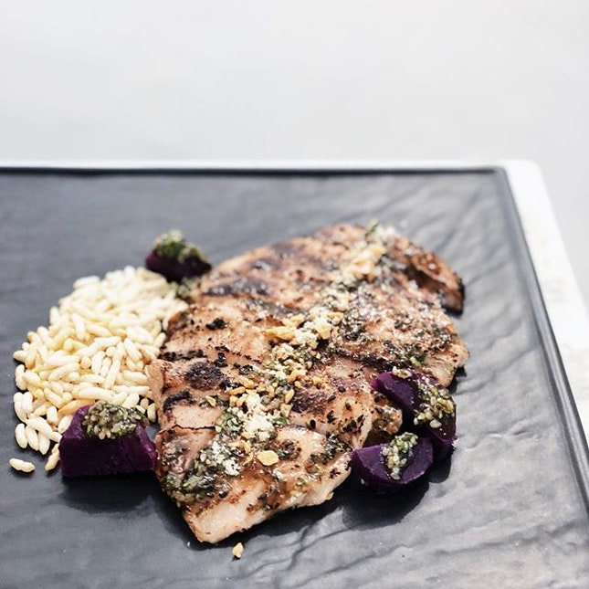 The pork jowl is served with a coriander garlic BBQ sauce, sweet potatoes and puffed rice.