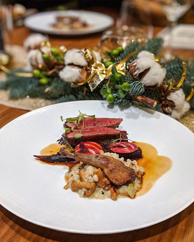 Cabernet wine poached pigeon served with parmigiano and chestnut barley risotto.