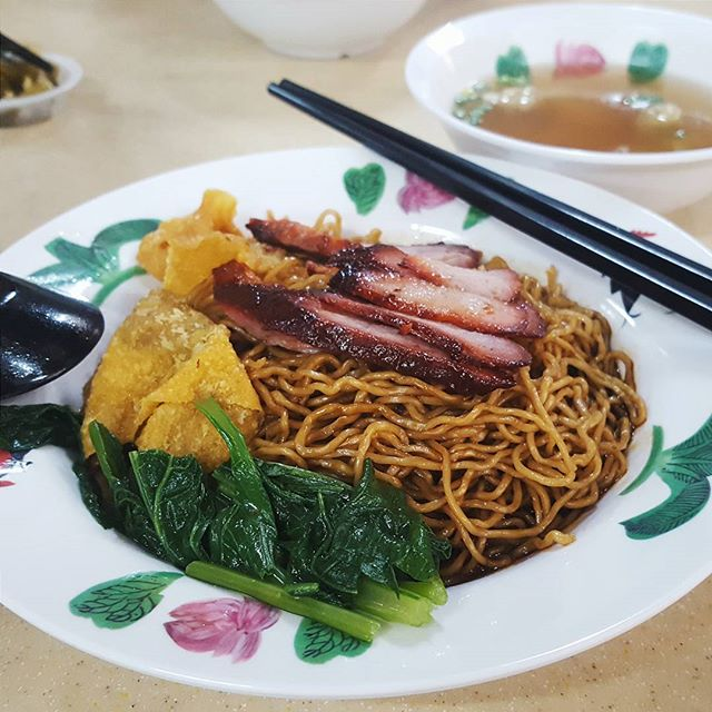"Nothing says ""SHIOK"" like a big plate of bouncy egg noodles coated in their special spicy black sauce, with a side of tender char siew."