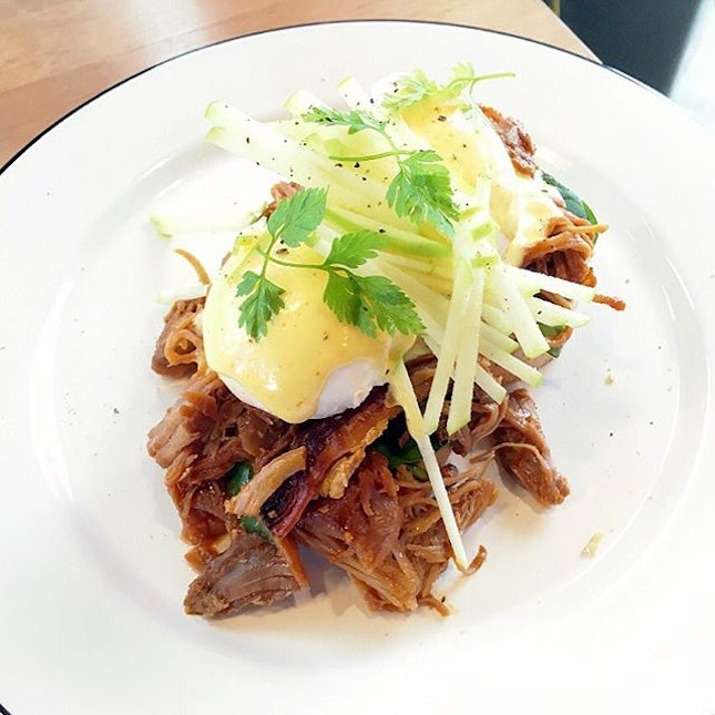 Pulled Pork Benedict ($15) Slow cooked juicy pork shoulder underneath two perfectly poached eggs – gold, runny and further topped with apple cider hollandaise, sitting above two hidden sourdough toast.