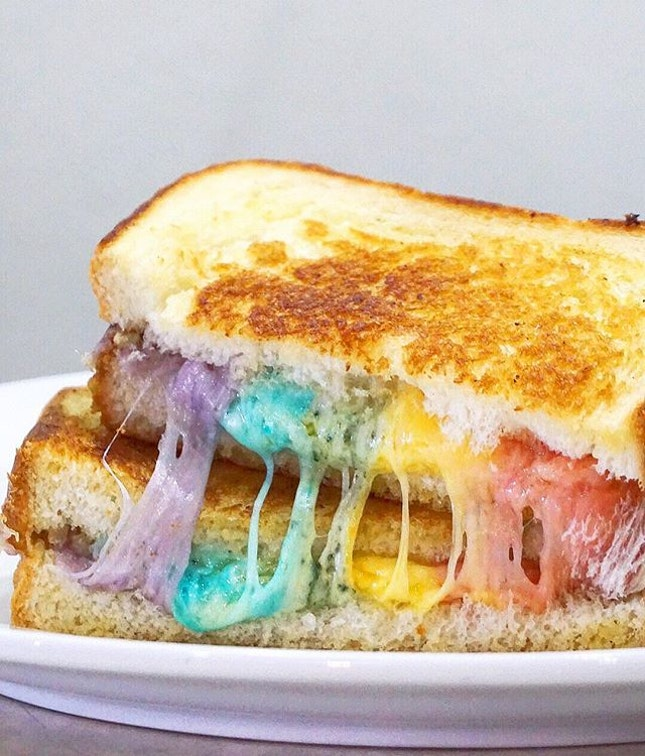 Rainbow Cheese Toastie ($9) Truffled grilled cheese naturally coloured with vegetables purée of beetroot (pink), carrot (orange), spinach (green), cauliflower/blue pea flower (blue) & red cabbage (violet).