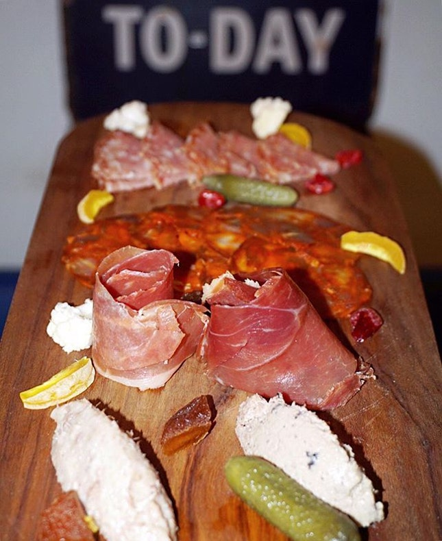 Charcuterie Connoisseur Board ($32) Assorted of speciality spiced & dry-cured meats served with sourdough bread on the side.