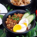 Taiwanese Braised Minced Pork Rice ($6.90) lined with juicy lean minced meat and a side of oozy runny egg.