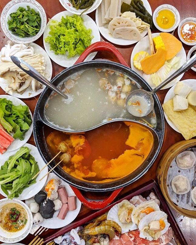 Conveyor belt hotpot buffet with free-flow xiaolongbao & soft-serve icecream?!