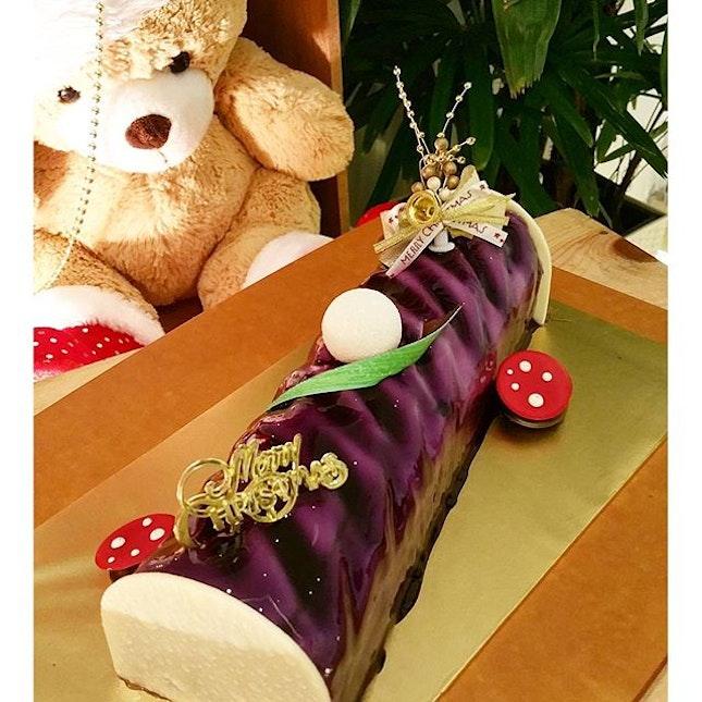 A very gorgeous purple Christmas log cake.