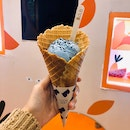 blue vanilla with lavender waffle cone