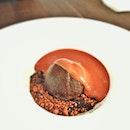 Bush Keluak Ice Cream (Rich and Earthy Buah Keluak Ice Cream, Made with 80% Valrhona Chocolate, on a Bed of Salted Caramel, Chocolate Crumble & Chili Specks, Topped with Warm Milk Chocolate Espuma) (Buah Keluak: is a tall tree native to the mangrove swamps of Southeast Asia.