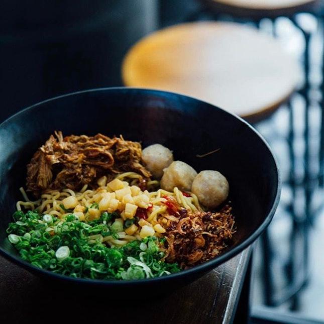 Spicy mee - Pulled Pork, Homemade Sambal, Pork Balls, Sesame Seeds, Pork lard, Signature 72 Degree Onsen Tamago.