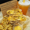 Mexican Pulled Beef Sandwich, Rosemary & Garlic Crispy Fries and Ice-Shaken Lemon Tea 🍟 Enjoy building your sandwich at Toasties with the wide range of fresh ingredients available: * Step 1: Choose SANDWICH (Chipotle Chicken, Mexican Pulled Beef, Cheese Steak, Masala Tofu & Chickpeas, Egg & Bacon, Smoked Chicken & Bacon, Tuna) * Step 2:  Choose ARTISAN BREAD (Italian Loaf, Garlic Oregano Loaf, Ciabatta) * Step 3: Pick TOPPINGS (Romaine, Tomatoes, Red Onions, Olives, Cole Slaw, Sautéed Onions, Bell Peppers, Haystack Onions, Jalapeños, Oven-Grilled Corn, Colby & Cheddar) and SAUCES (Mayonnaise, Garlic Aioli, Creamy Pesto, Ancho Chipotle) 🍟 The yummilicious sandwiches at Toasties are prepared in-house and made from scratch using the best quality ingredients.