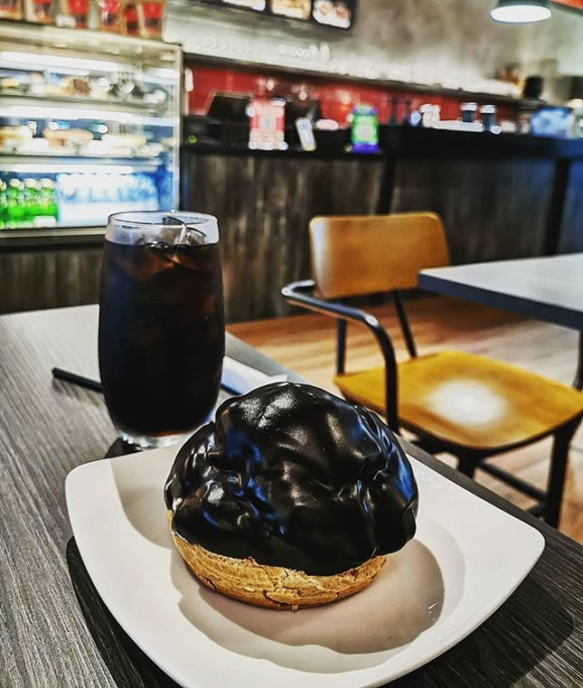 When koffie met bossche bol  Bossche bol (RM15.80) ∼pastry from the Dutch city, filled withwhipped creamand coated entirely or almost entirely with (usually dark)chocolatefondant icing.