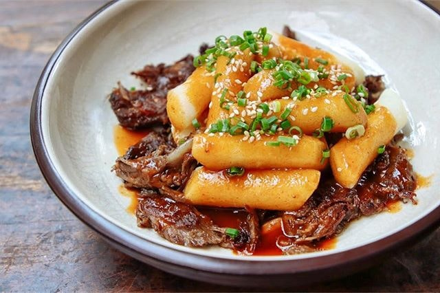 ; Lambbokki  Artichoke's signature slow-cooked Lamb Shoulder pulled to shreds, Joo Bar's crisp yet chewy Fried Tteokbokki with a good ladle of punchy Gochujang Gravy.