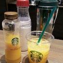 My orange juice and sis' mocha (in tumbler).