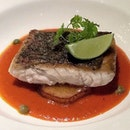 Pan Seared Barramundi $50 served with lime, lyonnaise potatoes and tomato sauce with olive oil & capers.