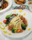 Pusheen Cat Nap Creamy Japanese Rice 🍚($22.90) Japanese bamboo charcoal rice with beetroot cream sauce, blanket by soft egg crepe, with crispy karaage chicken, star ⭐️ shaped carrots 🥕 & cheese 🧀 and fresh garden salad 🥗 .