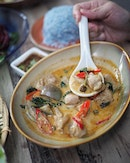 Green Curry Kampong Chicken ($24.00++) Mild Green Curry, Sweet Basil, Round EggPlant & Cumin.