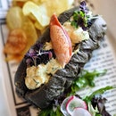 @antidotebar.sg Lobster Roll ($28.00++) Poached Marine Lobster, Mayo, Caviar topped on Charcol Bun.