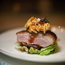 Roasted Irish Duck with Crispy Rice in Chef's Special Sauce ($52.00/half, $90.00/whole)