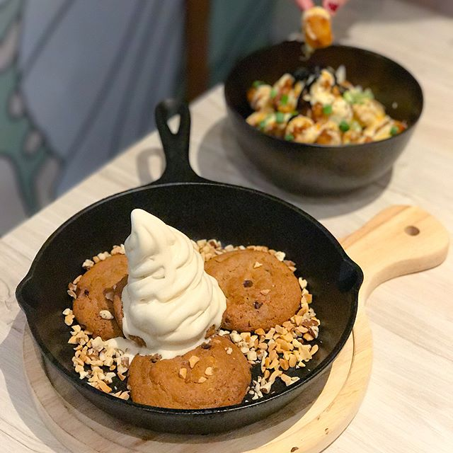 Warm pb cookie [$13++] Warm peanut butter chocolate chip cookies topped with salted speculoos softserve and garnished with crushed, grounded nuts, served on a hot skillet pan.