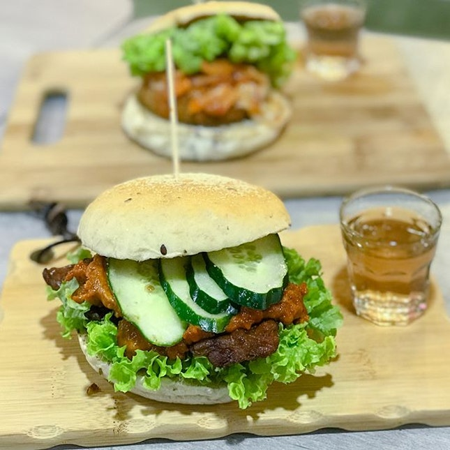 Temptation satay [$8.90]  Sandwiched between 2 wholemeal bun lies a thick marinated tempeh patty, topped with homemade satay sauce, Japanese cucumber and coral lettuce.