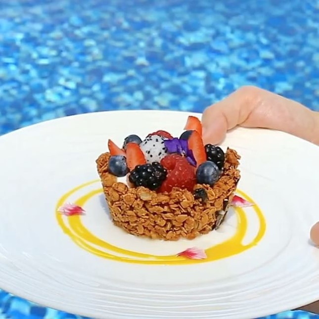 Baked Granola Tart with Low Fat Yogurt & Mixed Berries by the poolside.