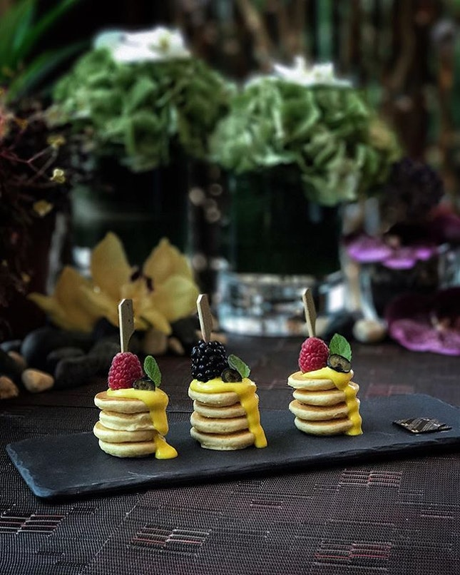 Mini Pancakes Stack with Mixed Berries & Passion Fruit Cream ( $8 ).